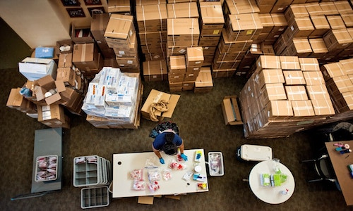 A bird's-eye view of boxes upon boxes of samples arriving from testing sites on the Duke University campus.